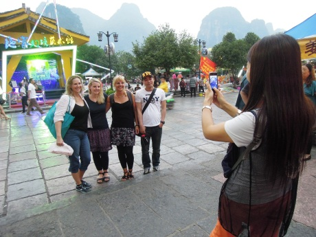 The tourists became the attraction. To many blond haired women in this Group:) Photo by Alison Chang